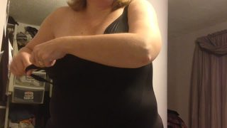 Covering Her Big Tits With Her Black Girdle