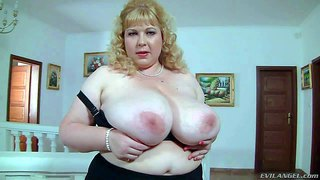 Chubby blonde angelynne hart is proud of her unthinkably big natural breasts. she pulls down her black bra and shows off her enormous knockers. watch her shake her giant jugs!