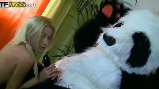 Teen blonde girl sally is giving hot blowjob to her boyfriend that is dressed up in panda bear suit and fucks him.