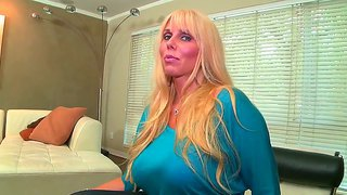 Marvellous Milf, Karen Fisher, Demonstrates Her Big Melons And Strips On Camera