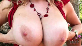 Blonde with massive tits plays with herself under the hot sun