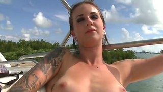 Piercings With Shaved Snatch Plays With Her Moist Beaver After Stripping