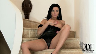 Spiffing rich lady sits on a staircase and tastes her own dripping pussy