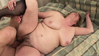 Fat granny eats some meat and then gets her sloppy cunt drilled