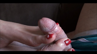 Pretty red toes and a footjob