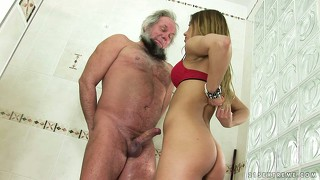 The cutie wraps her lips around his cock preparing it for a hot stand up fuck