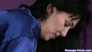 Busty brunette masseuse gives a nice massage and chomps on his rod