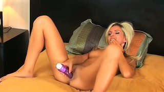 Fabulous Blonde Heidi Brooks Plays With Her Amazing Shaved Pussy On The Bed And Her Sex Toy