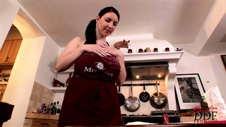 Big, natural tit brunette cooks in the kitchen and shows her huge boobs