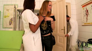 Nurse and administrator do each other while the doctor watches on