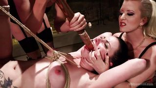 Slave gets a big dildo shoved in her mouth