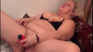 Chubby Granny Works Her Shaven Pussy With A Dildo