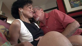 Elegant skinny granny sage hughes in stylish black and white dress gets mouth fucked by silver haired aged man on the couch in the living room. she enjoys his beefy cock in her hot mouth!