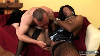Appealing, chocolate tranny is stroking hard penis of her friend