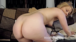 Danniella Plays With Her Hairy Pussy On The Couch