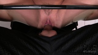 Blonde slave gags and chokes helplessly on her master's cock