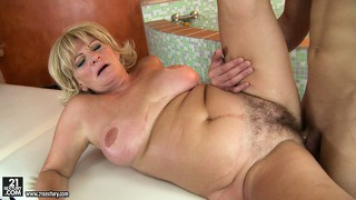 He drills her and then lays her down to fuck and gets a titty fuck