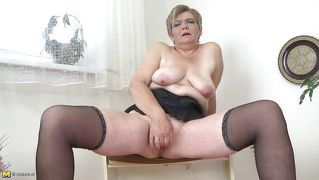 Granny Masturbates With Black Dildo