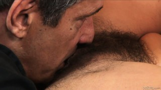 Tanned milf gets her hairy snatch?s lips parted and eaten out
