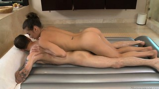 Her adorable oiled up body quivers with pleasure as he pounds her cunt from behind