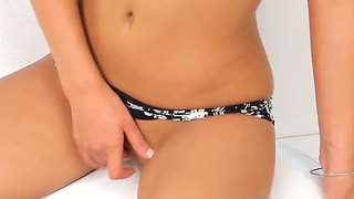 A Curly Haired Vixen Fingers Her Tight Box