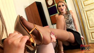 Horny dykes in stockings suck on their feet while at the office