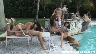It's now a wild sex party with women eating pussy or cock by the pool