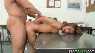 Bending over the desk, the seductive horny babe with perky tits enjoys a deep fucking