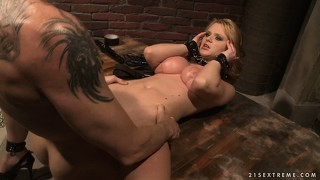 Petite blonde in bondage gear gets a load of cum in her mouth