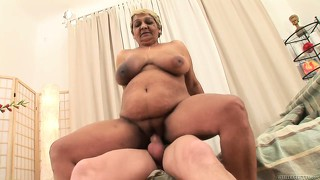 Blonde mature lady with huge tits and a fat ass is yearning for some sex action