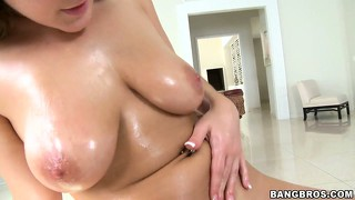 Curvy chick gets her bust and ass oiled up and mounts a big cock