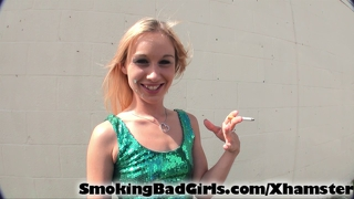 Teen smokes cigarette outside in dress flashing