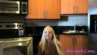 Playful blonde in cute undies teases by stripping in the kitchen