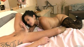 This asian cougar in slutty black stockings fucks his young cock like an animal