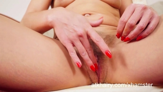 Charli Shay Fucks Her Hairy Pussy With A Red Toy