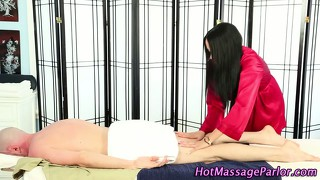 Brunette Masseuse Sucking