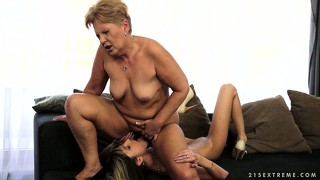 Granny and her petite blonde play mate slicking pussy and scissoring together