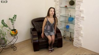 Slim Girl Posing On An Armchair