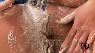 Chubby brunette broad with massive tits soaps herself up real good