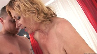 Blonde milf with a hairy pussy and sexy tits is on the prowl for a wild adventure