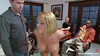 Naked blonde krissy lynn with huge boobs spreads her buttocks and gives a backside view of her pink juicy pussy in front of five curious guys. she gets trained to obey after poker game.