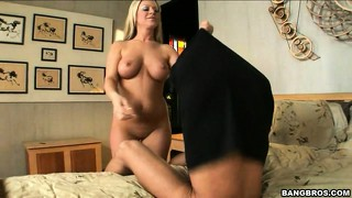 Blonde with stonking tits gets naked before giving a handjob