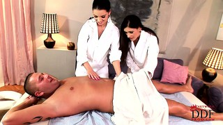 Two masseuses are ready to puts the moves on his stiff cock together