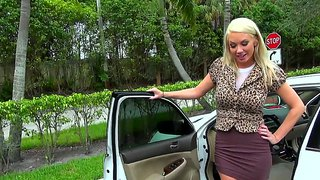 Busty blond milf negotiating with car salesman
