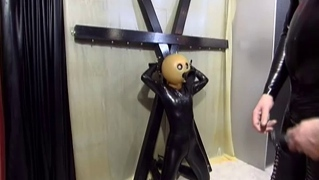 German Slut In Black Latex And Bizarre Mask In Bondage