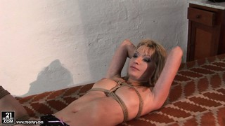 She's tied up on the floor and her mistress sits on her and whacks her