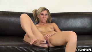 Blonde babe with pony tails fucks her pussy with a curvy dildo