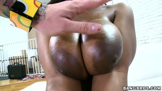 Ebony's mississippi tits are eager to wrap around a juicy white cock