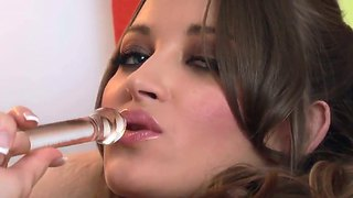 The prepossessing pornstar dani daniels in a stockings penetrates her shaved pussy with glass dildo
