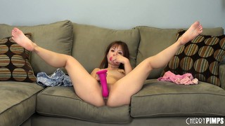 Asia zo fills her intimate cavity with pink sex toy and smiles for cam